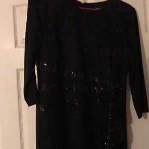Black sequined evening gown.